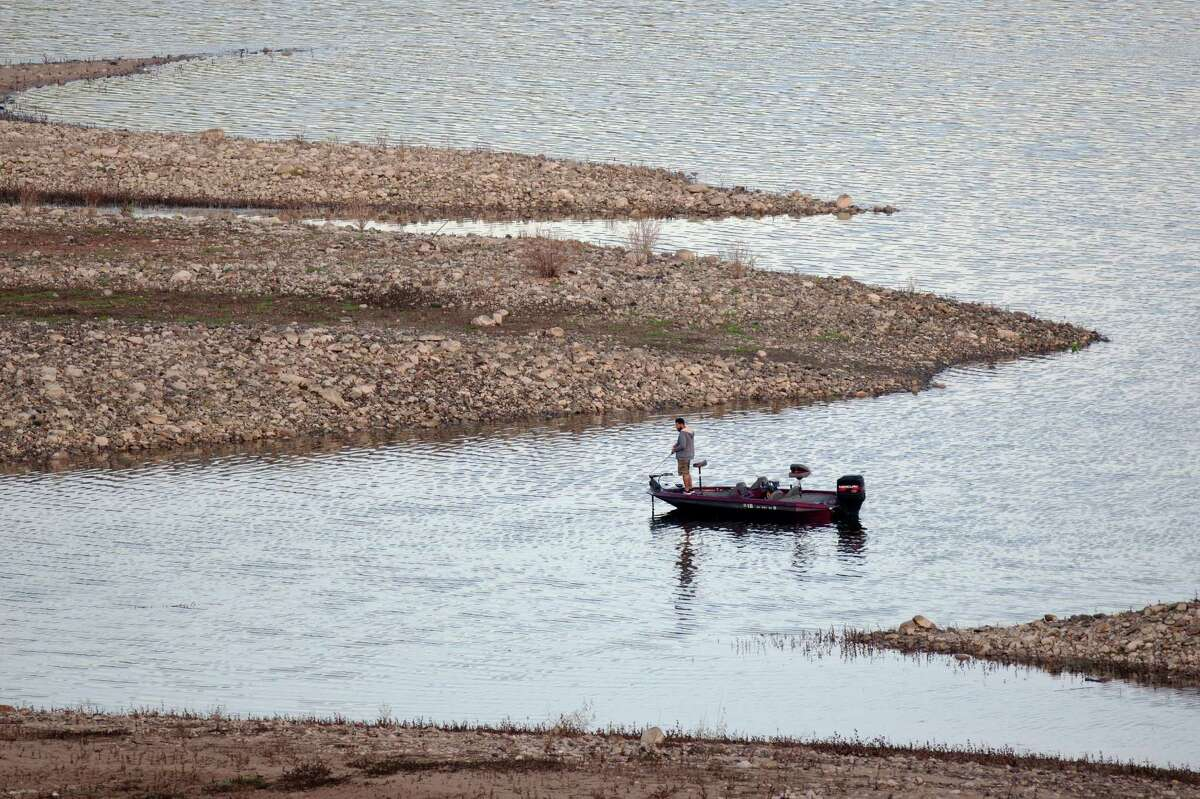 A fisherman fishes the low waters of Lake Success as rain totals remain insufficient to break the worsening drought on February 11, 2015 near East Porterville, California. Many local residents, whose water wells have run dry, fill their tanks with free non-potable water for flushing toilets, bathing and laundering and use bottled water for drinking and washing dishes. Many of the dry wells of 926 homes in Tulare County dried up last summer when some 17 California communities ran out of water.