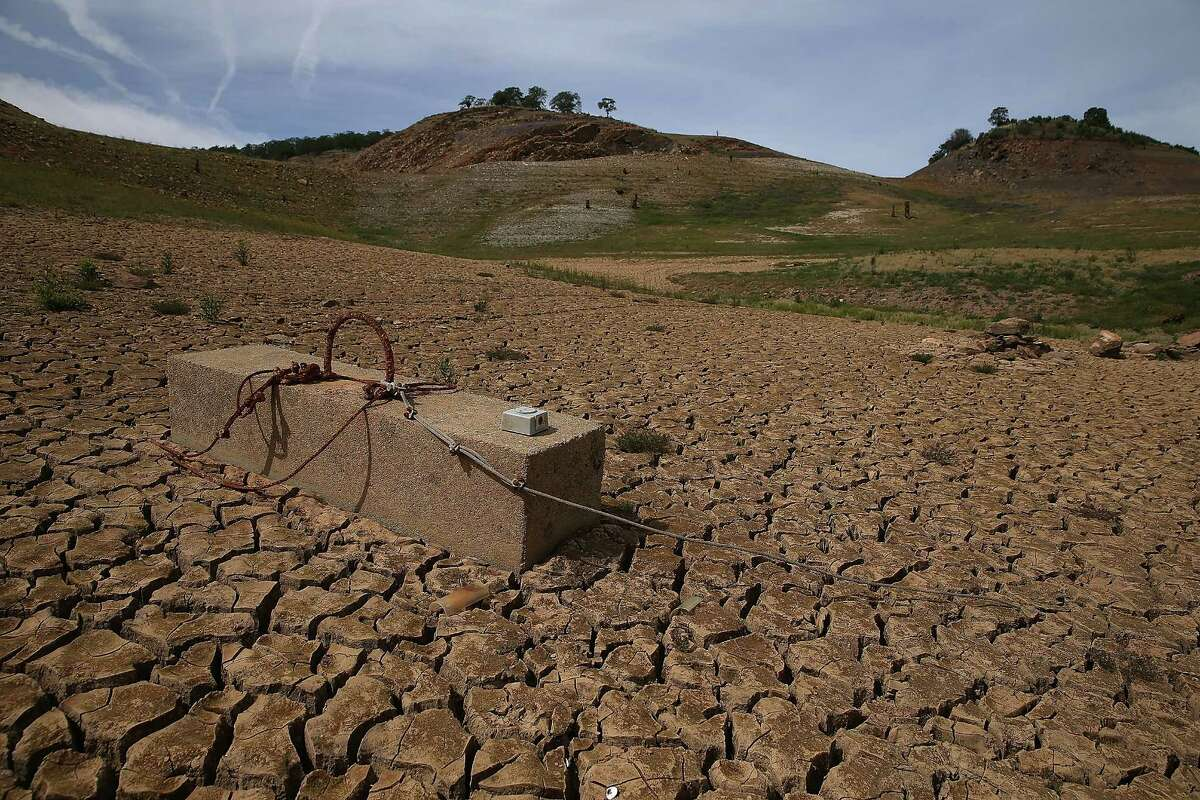 The snows of February have restored the Sierra Nevada snow pack and given California a respite from drought. A concrete block that was used to hold a boat dock sits in dry cracked earth that used to be the bottom of Lake McClure on March 24, 2015 in La Grange, California. More than 3,000 residents in the Sierra Nevada foothill community of Lake Don Pedro who rely on water from Lake McCLure could run out of water in the near future if the severe drought continues. Lake McClure is currently at 7 percent of its normal capacity and residents are under mandatory 50 percent water use restrictions.