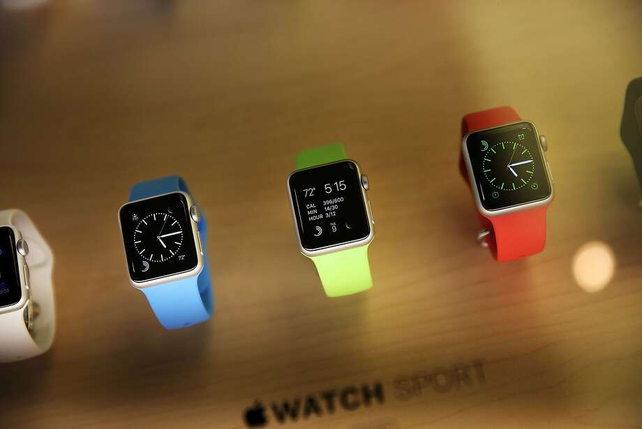"""NEW YORK, NY - APRIL 10:  The new Apple Watch is viewed at an Apple store in Manhattan on April 10, 2015 in New York, New York. Consumers around the world were able to try on the long awaited smartwatch on Friday and to place orders. On April 24, consumers will be able to buy it online or by appointment in select stores. The Apple Watch sport starts at $349 with the standard version retailing at $549 in the U.S. Luxury """"Edition"""" watches with 18-karat gold alloys will be priced from $10,000 and will go as high as $17,000.  (Photo by Spencer Platt/Getty Images) Photo: Spencer Platt, Getty Images"""