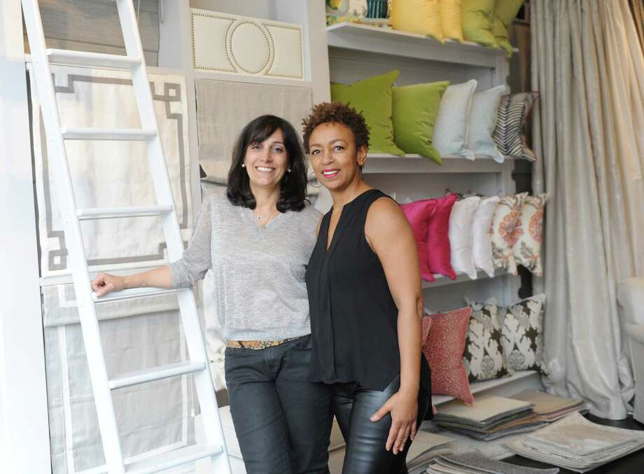 Curtain Works owners Elena Loscher, left, and Linda DeSouza pose in their store on East Putnam Avenue in Greenwich, Conn. Thursday, April 23, 2015.  The design district near the top of Greenwich Avenue is a major attraction for interior deisgners and stagers with so many stores close together. Photo: Tyler Sizemore / Greenwich Time
