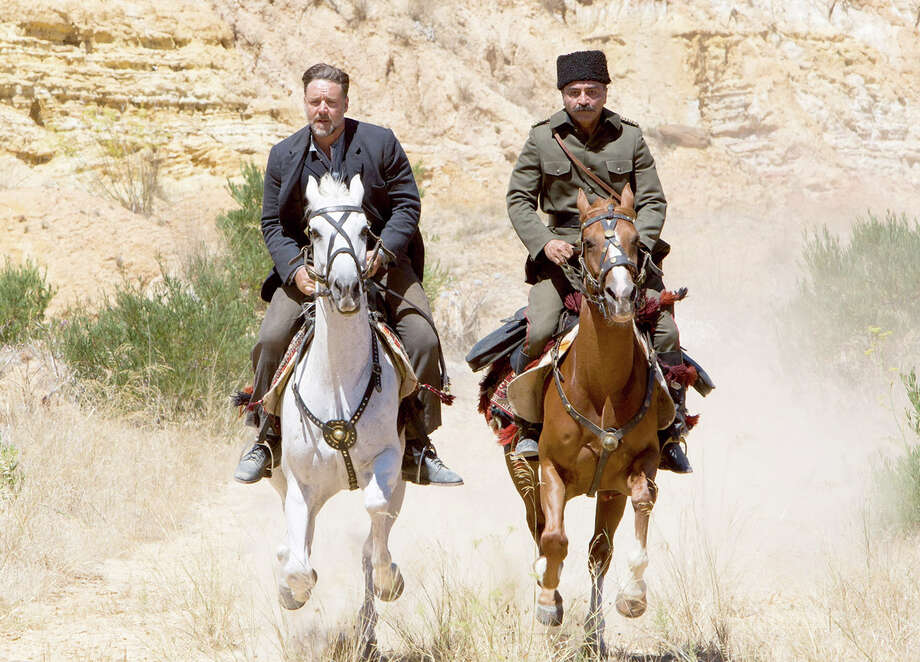 "(L-r) Russell Crowe as Joshua Connor and Yilmaz Erdogan as Major Hasan in the drama ""The Water Diviner,"" which marks Crowe's directorial debut. Illustrates FILM-DIVINER-ADV24 (category e), by Ann Hornaday © 2015, The Washington Post. Moved Wednesday, April 22, 2015. (MUST CREDIT: Mark Rogers/ Warner Bros. Pictures.) Photo: HANDOUT / THE WASHINGTON POST"