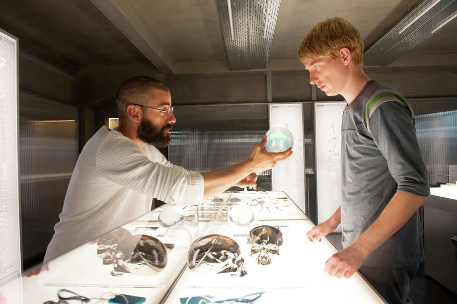 """(L-r) Oscar Isaac and Domhnall Gleeson provide two of three terrific performances in """"Ex Machina."""" Illustrates FILM-EXMACHINA-ADV17 (category e), by Ann Hornaday © 2015, The Washington Post. Moved Wednesday, April 15, 2015. (MUST CREDIT: A24.) Photo: HANDOUT / THE WASHINGTON POST"""