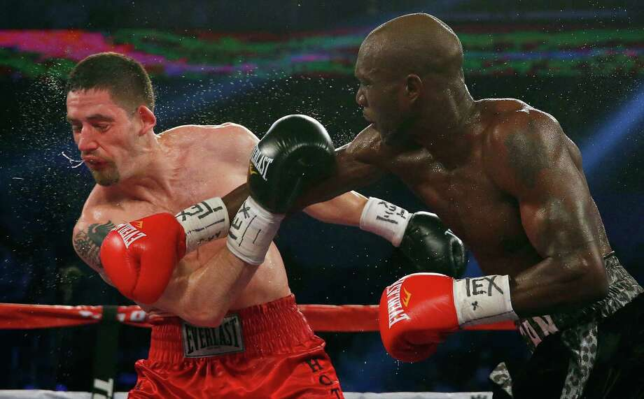 San Antonio's Benjamin Whitaker (right) lands a punch against Skender Halili in the sixth round of their welterweight bout at College Park Center on April 18, 2015 in Arlington, Texas. Photo: Tom Pennington /Getty Images / 2015 Getty Images