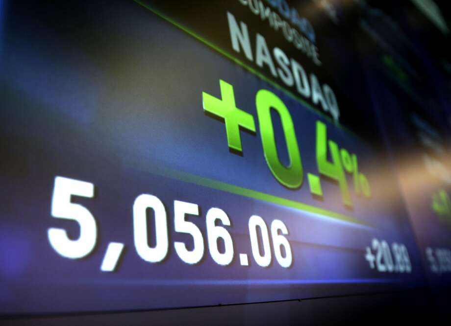 The Nasdaq composite index bested its 2000 record with its Thursday close of 5,056.06. It added 36 points on Friday. Photo: Seth Wenig, Associated Press