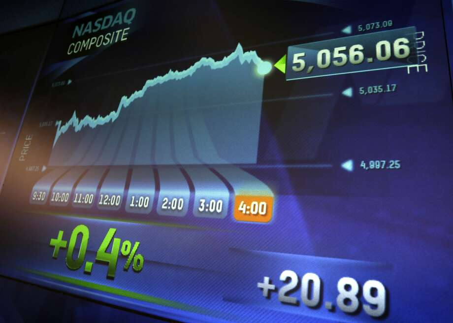 Market data is displayed on the screens at the Nasdaq MarketSite in New York, Thursday, April 23, 2015. The Nasdaq composite has closed at a record high for the first time since the dot-com bubble of 2000. (AP Photo/Seth Wenig) Photo: Seth Wenig, Associated Press
