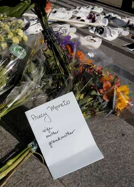 A note is placed along with flowers, on Friday Nov. 7, 2014, as members of San Francisco's Vision Zero Coalition gathered on the steps of City Hall in San Francisco, Calif. to draw attention to the alarming increase of traffic related deaths on the streets of the city in 2014.
