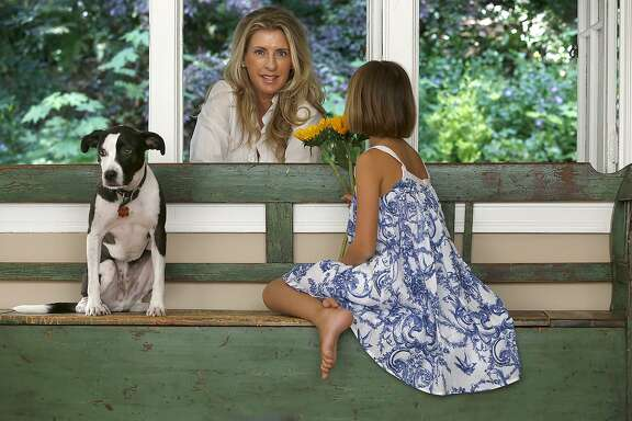 Tara Verkuil and her daughter, Lucy, 8 years old, with Oliver spend time at home in Larkspur, California,  on Wednesday, April 22, 2015.