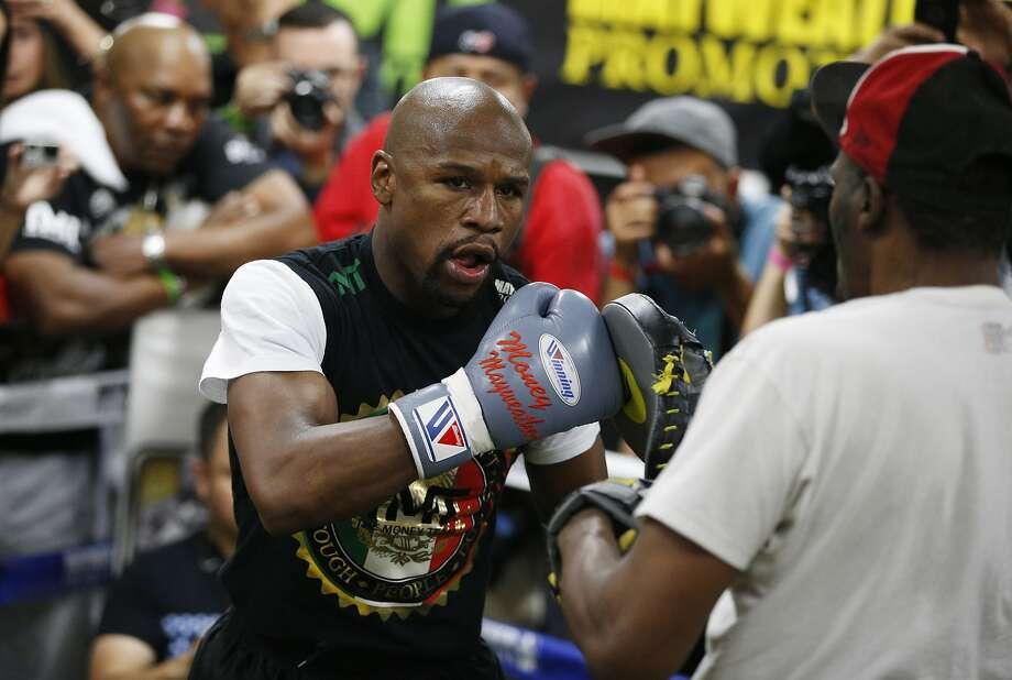 Boxer Floyd Mayweather Jr.ing match in Las Vegas on May 2. (AP Photo/John Locher) Photo: John Locher, Associated Press