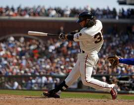 San Francisco Giants' Brandon Crawford hits game-tying RBI triple in 9th inning against Los Angeles Dodgers in MLB game at AT&T Park in San Francisco, Calif., on Thursday, April 23, 2015.
