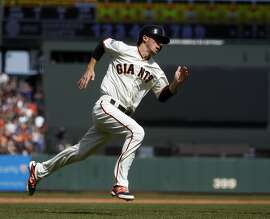 San Francisco Giants' Matt Duffy scores on Brandon Crawford's game-tying RBI triple in 9th inning against Los Angeles Dodgers in MLB game at AT&T Park in San Francisco, Calif., on Thursday, April 23, 2015.