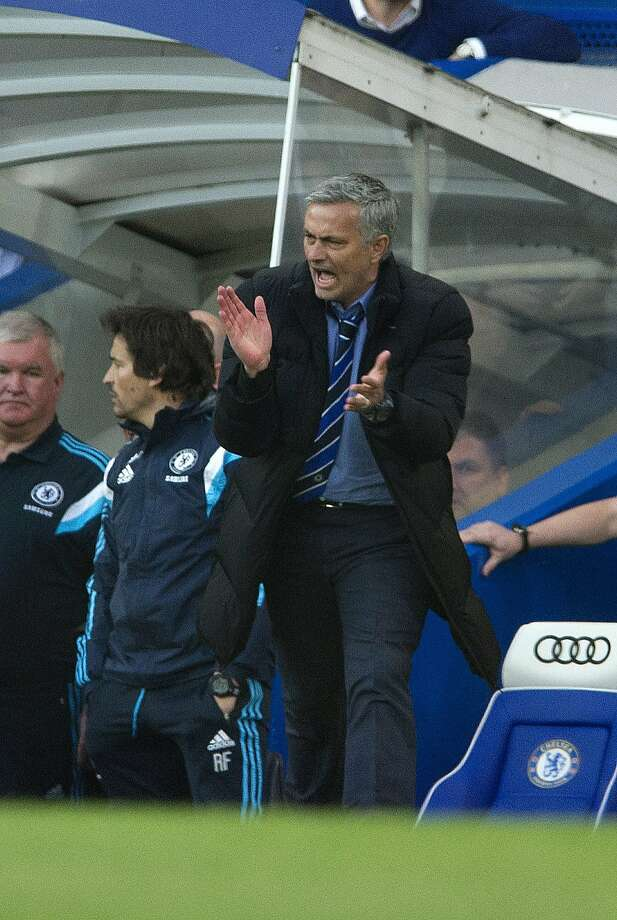 Chelsea's manager Jose Mourinho reacts, during the English Premier League soccer match between Chelsea and Manchester United, at Stamford Bridge Stadium in London, Saturday, April 18, 2015. (AP Photo/Bogdan Maran) Photo: Bogdan Maran, Associated Press