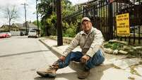 """Steve Bermudez sits outside his house in the Glen Park neighborhood in the Near Northside. """"There is always going to be change in the city. It's important we learn to adjust,"""" Bermudez says. """"But some things, we don't want to adjust to."""""""