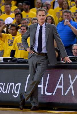 OAKLAND, CA - APRIL 20:  Head coach Steve Kerr of the Golden State Warriors looks on against the New Orleans Pelicans in the second quarter during the first round of the 2015 NBA Playoffs at ORACLE Arena on April 20, 2015 in Oakland, California. NOTE TO USER: User expressly acknowledges and agrees that, by downloading and or using this photograph, User is consenting to the terms and conditions of the Getty Images License Agreement.  (Photo by Thearon W. Henderson/Getty Images)