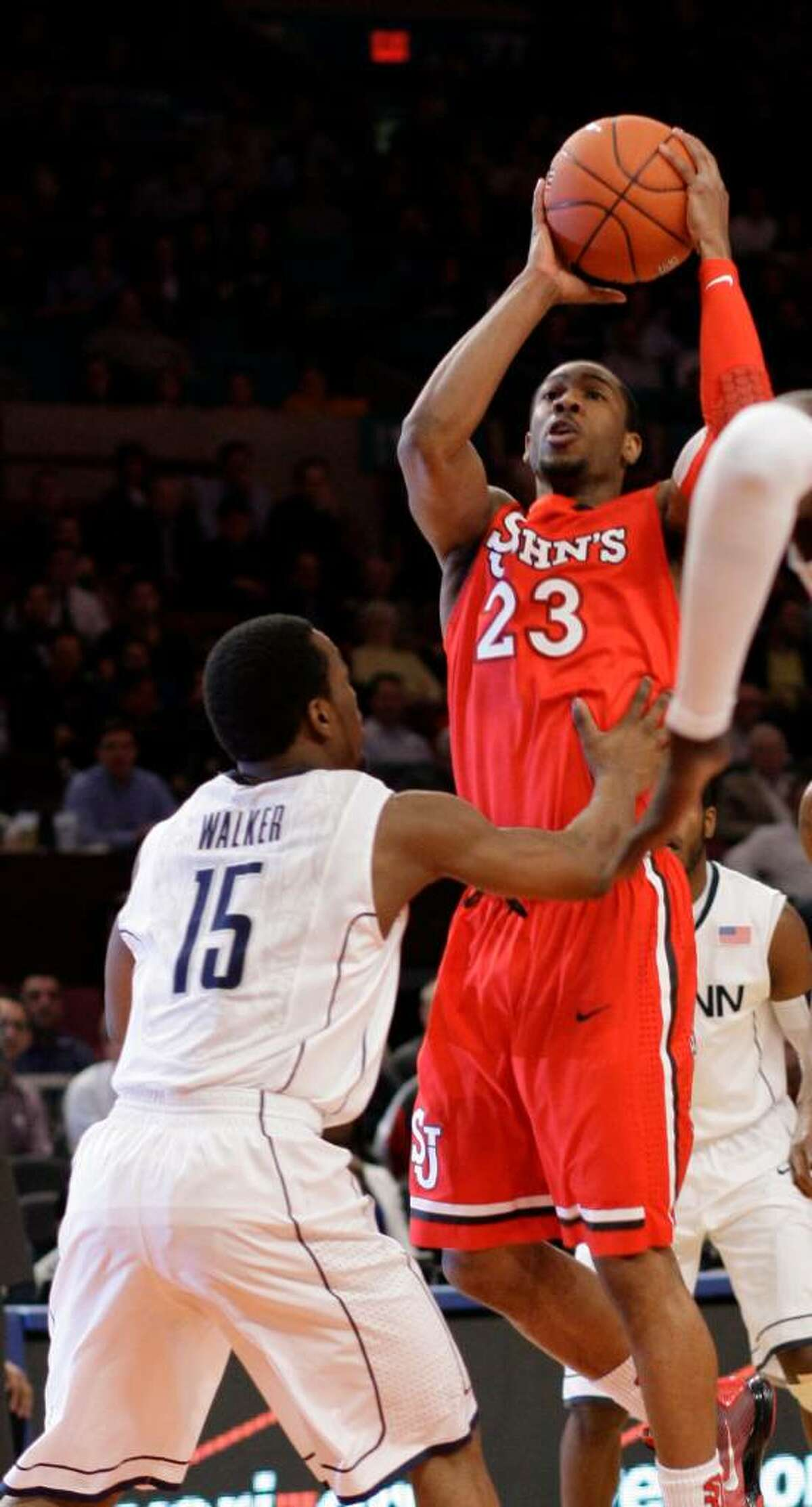St. John's Paris Horne (23) shoots over Connecticut's Kemba Walker (15) during the first half of a first round NCAA college basketball game at the Big East Conference Championships on Tuesday, March 9, 2010 in New York. (AP Photo/Frank Franklin II)