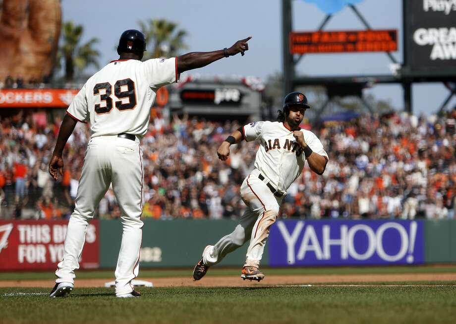 San Francisco Giants' Angel Pagan heads home with the game-winning run after a single by Justin Maxwell in 10th inning of 3-2 win over Los Angeles Dodgers in MLB game at AT&T Park in San Francisco, Calif., on Thursday, April 23, 2015. Photo: Scott Strazzante, The Chronicle