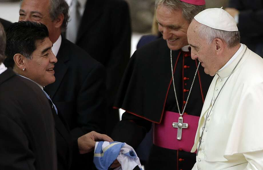 FILE -- In this Sept. 1, 2014 file photo, Argentine soccer legend Diego Armando Maradona, left, greets Pope Francis in the Paul VI hall at the Vatican. Diego Maradona says he's Pope Francis' top fan. The retired Argentina soccer great met with the pope Thursday, April 23, 2015 to help promote an education charity that Francis started in Argentina when he was the archbishop of Buenos Aires. (AP Photo/Gregorio Borgia, File) Photo: Gregorio Borgia, Associated Press