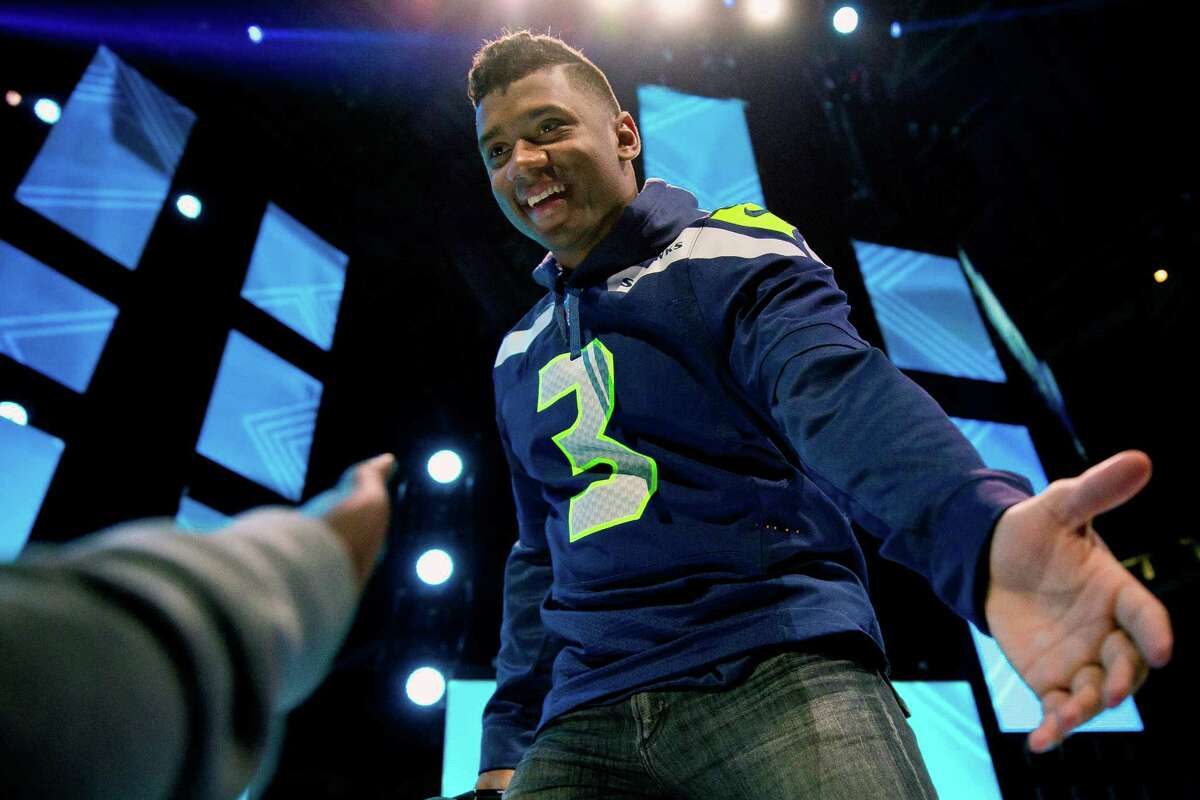 Seahawks quarterback Russell Wilson greets thousands of screaming fans during the annual