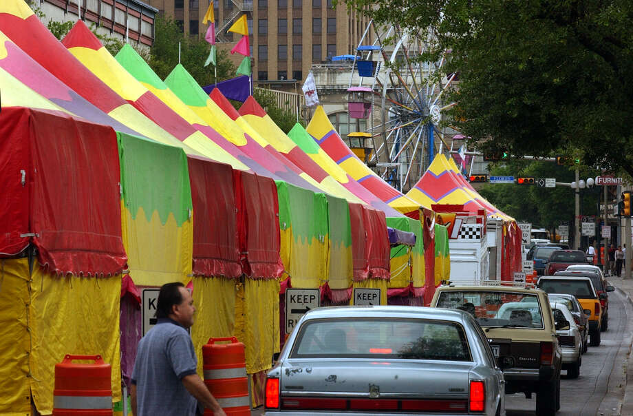 Game booths and rides line the 700 block of Dolorosa Street in 2003. From 1974 to 2007, it was the home of the Fiesta Carnival. Photo: San Antonio Express-News File Photo / SAN ANTONIO EXRESS-NEWS