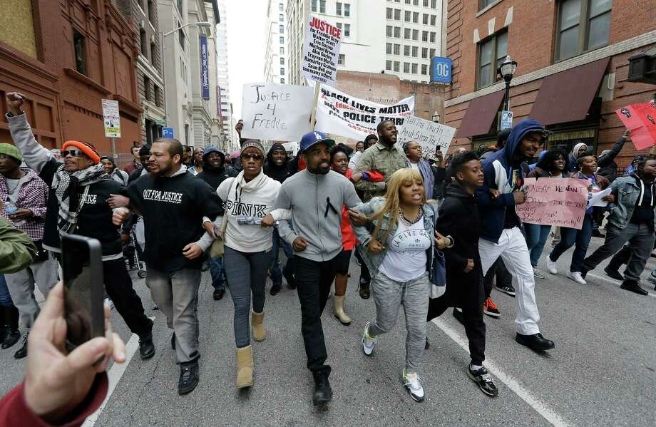 Protesters march for Freddie Gray through downtown Baltimore. Gray died from spinal trauma a week after being arrested and transported in a police van. Photo: Patrick Semansky /Associated Press / AP