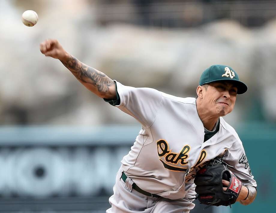 Starter Jesse Chavez, delivering a pitch in the first inning, and A's relievers allowed only one hit in the game, but it was a two-run homer in a 2-0 loss. Photo: Harry How, Getty Images