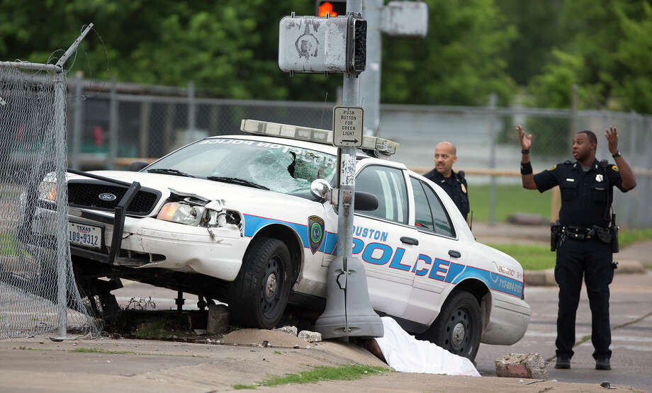 The fatal accident involving a police cruiser and a bicyclist occurred at about 4 a.m., officers said. Photo: Cody Duty, Staff / © 2015 Houston Chronicle