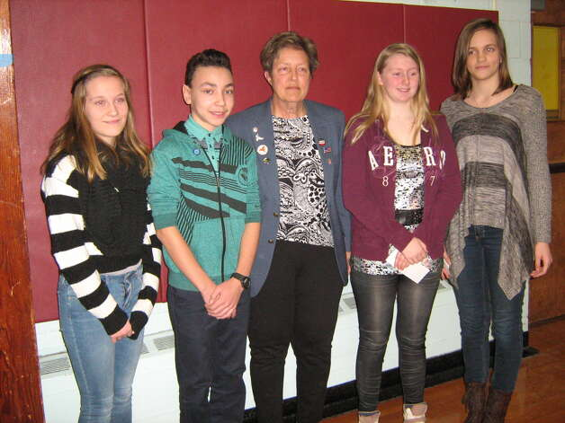 Watervliet Elks 1500 recently visited Menands, Heatly and Watervliet Elementary schools to give out awards to students for their Americanism essays. From left are Macy Hayes, Dennis Howard, Elks representative Colleen Quackenbush, Meghan Devane and Ksenia Valihunda from Menands School. (Nancy Caswell)