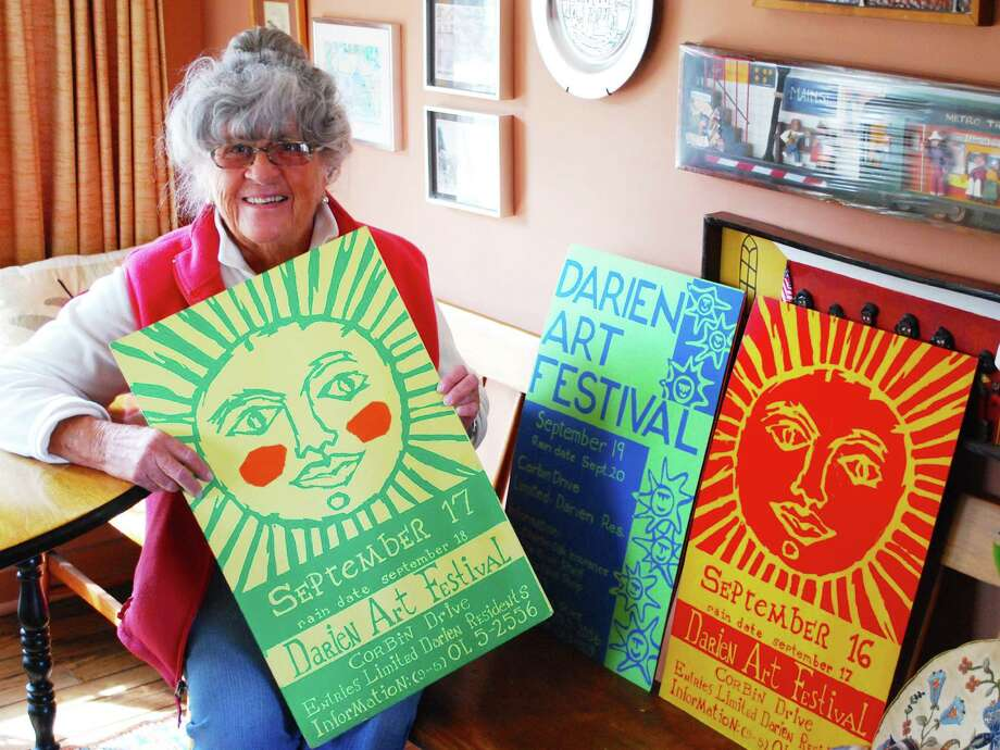The Darien Arts Centerís 57th Annual Art Show & Sale will be held May 30 through June 6. Artists may register online through May 26 at 7 p.m. The art show has a rich history. Above, Pat Atkin shares original posters she created and silk-screened for some of the early years of the event, then called the Darien Art Festival. For details and to register, go to darienarts.org or call (203) 655-8683. Photo: Contributed Photo / Darien News