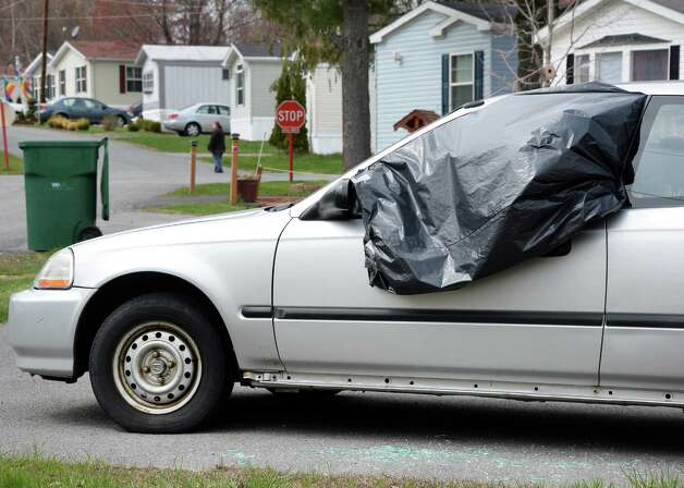 A car with its window shot out at D and R Mobile Home Community Thursday April 23, 2015, in Half Moon, NY.   (John Carl D'Annibale / Times Union) Photo: John Carl D'Annibale / 00031583A