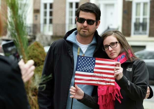 A crime victim's family members, Jeff and Nicole Horowitz are photographed with a flag with Nicole's brother's name, Jason Willis inscribed on it at the Albany County Crime Victims Memorial in Thursday afternoon April 23, 2015 after the service for crime victims was held in the Albany County Courthouse in Albany, N.Y.           (Skip Dickstein/Times Union) Photo: SKIP DICKSTEIN / 00031560A