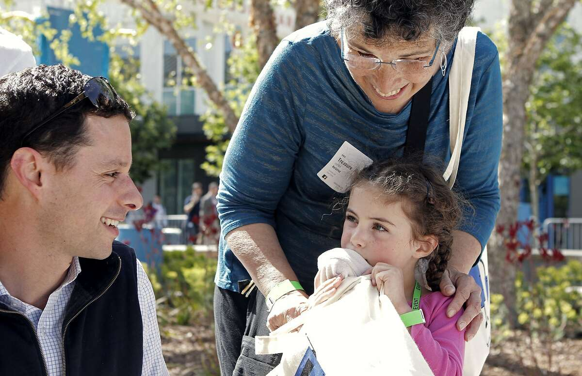 Dan Levy, Lea Levy and her grandmother Treasure Cohen at Take Your Child to Work Day in Hacker Square on Facebook's campus in Menlo Park, Calif., Saturday April 23, 2015.