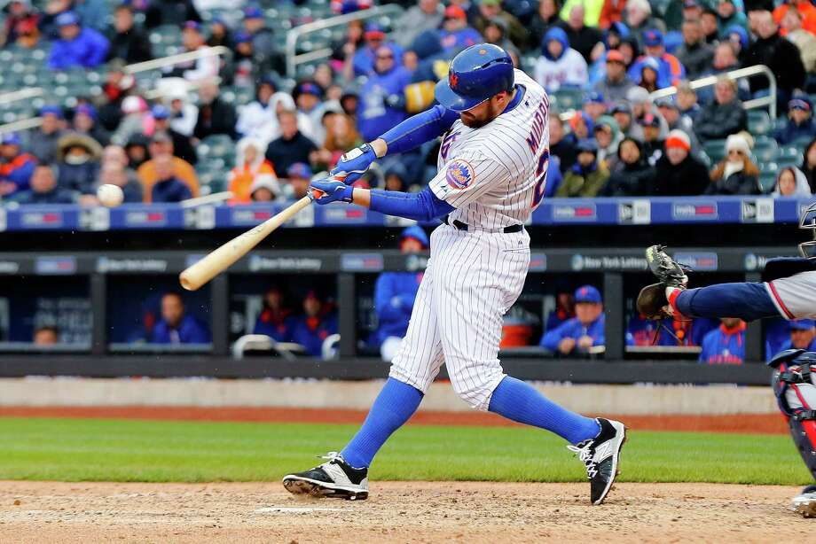 NEW YORK, NY - APRIL 23:  Daniel Murphy #28 of the New York Mets connects on a seventh inning RBI base hit against the Atlanta Braves at Citi Field on April 23, 2015 in the Flushing neighborhood of the Queens borough of New York City.  (Photo by Jim McIsaac/Getty Images) ORG XMIT: 538577921 Photo: Jim McIsaac / 2015 Getty Images