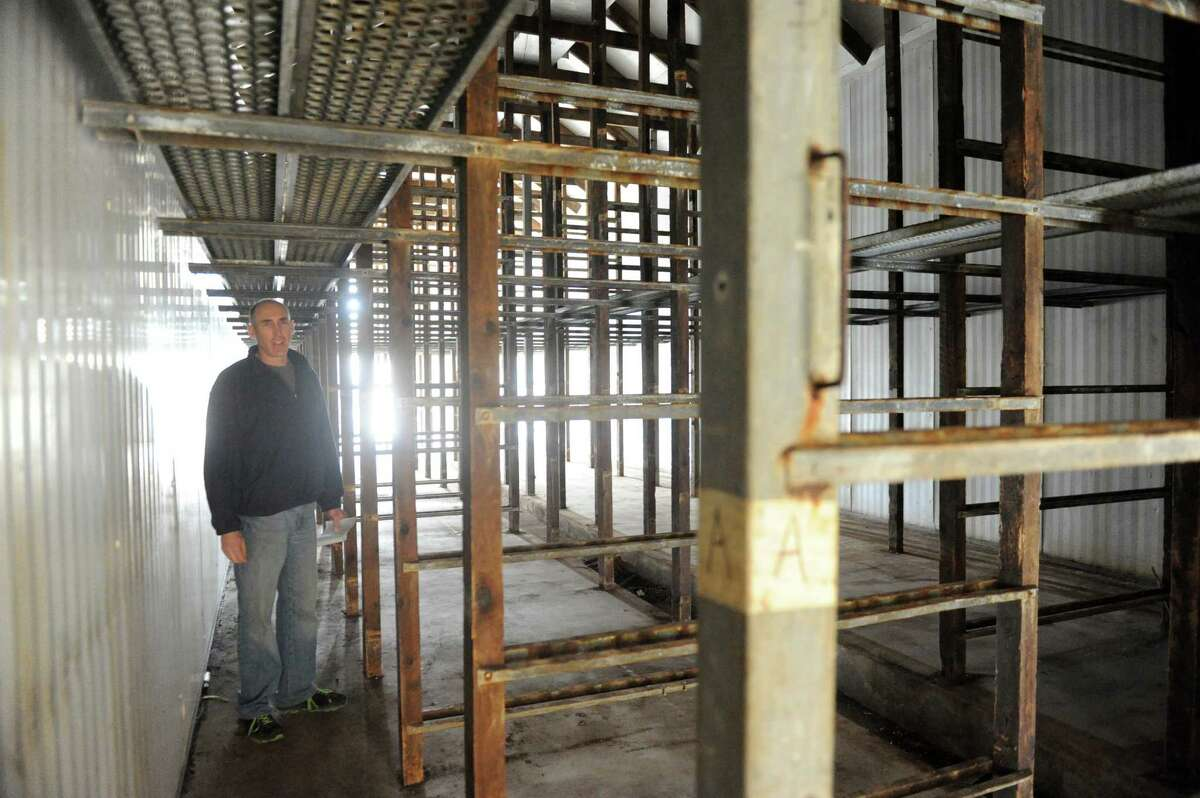 Stephen Lulla stands in one of the former mushroom barns that will be converted to grow marijuana during Compassionate Relief Centers of New York, Inc. Open House on Thursday April 23, 2015 in Jackson, N.Y. (Michael P. Farrell/Times Union)