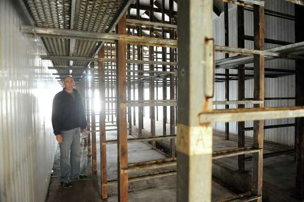 Stephen Lulla stands in one of the former mushroom barns that will be converted to grow marijuana during Compassionate Relief Centers of New York, Inc. Open House on Thursday April 23, 2015 in Jackson, N.Y. (Michael P. Farrell/Times Union) Photo: Michael P. Farrell / 00031546A