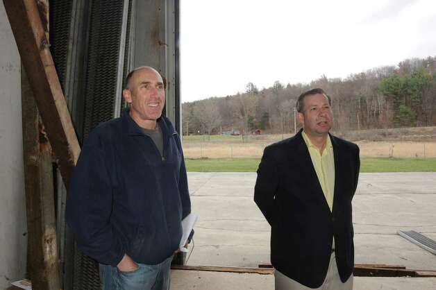 Stephen Lulla, left, Co-CEO/CFO, and Ted Berndt, Co-CEO/COO, of Compassionate Relief Centers, inside the Washington County Agri-Business a former mushroom facility that will be converted to grow marijuana during Compassionate Relief Centers of New York, Inc. Open House on Thursday April 23, 2015 in Jackson, N.Y. (Michael P. Farrell/Times Union) Photo: Michael P. Farrell / 00031546A