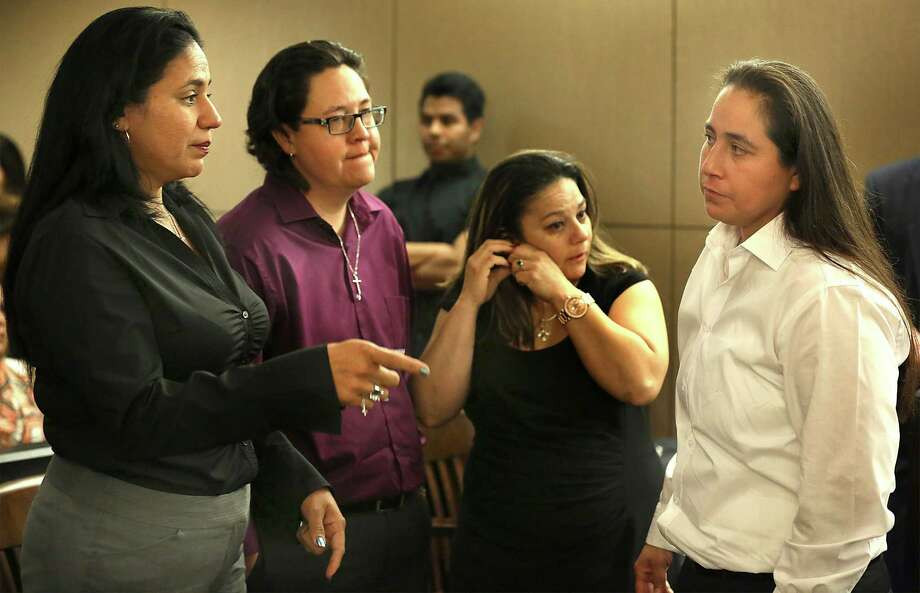 The SA Four, Cassandra Rivera, from left, Kristie Mayhugh, Elizabeth Ramirez, and Anna Vasquez,  gather to talk at the end of the hearing in Bexar County Court to determine if they should be declared actually innocent of a sexual crime that they were found guilty of, or possibly sent back to prison.   Thursday, April 23, 2015. Photo: Bob Owen, Staff / San Antonio Express-News / ©2015 San Antonio Express-News