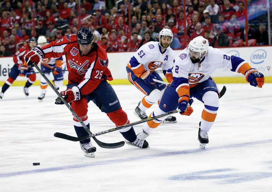 Washington Capitals left wing Jason Chimera (25) skates with the puck as New York Islanders defenseman Nick Leddy (2) defends during the first period of Game 5 in the first round of the NHL hockey Stanley Cup playoffs, Thursday, April 23, 2015, in Washington. (AP Photo/Alex Brandon) ORG XMIT: VZN107 Photo: Alex Brandon / AP