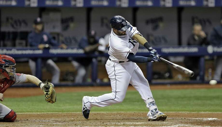 Tampa Bay Rays' Rene Rivera hits a walk-off single off Boston Red Sox relief pitcher Anthony Varvaro during the ninth inning of a baseball game Thursday, April 23, 2015, in St. Petersburg, Fla. Rays Tim Beckham came around to score. Catching for Boston is Ryan Hanigan. Tampa Bay won 2-1. (AP Photo/Chris O'Meara)  ORG XMIT: SPD112 Photo: Chris O'Meara / AP
