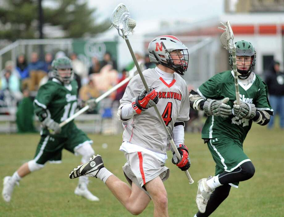 Niskayuna's Jake Shephard, center, carries the ball as Shen's Willy Stevenson, left, and Peter Russo defend during their lacrosse game on Thursday, April 23, 2015, at Niskayuna High in Niskayuna, N.Y. (Cindy Schultz / Times Union) Photo: Cindy Schultz / 00031568A
