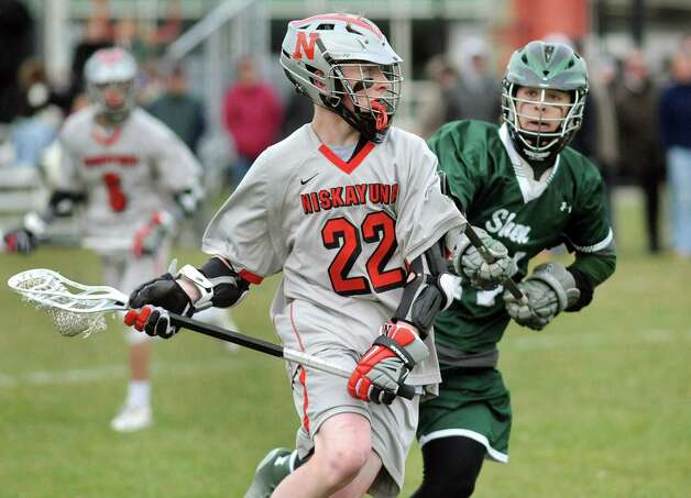 Niskayuna's James Sexton, center, carries the ball as Shen's Joey Pucciarelli defendS during their lacrosse game on Thursday, April 23, 2015, at Niskayuna High in Niskayuna, N.Y. (Cindy Schultz / Times Union) Photo: Cindy Schultz / 00031568A