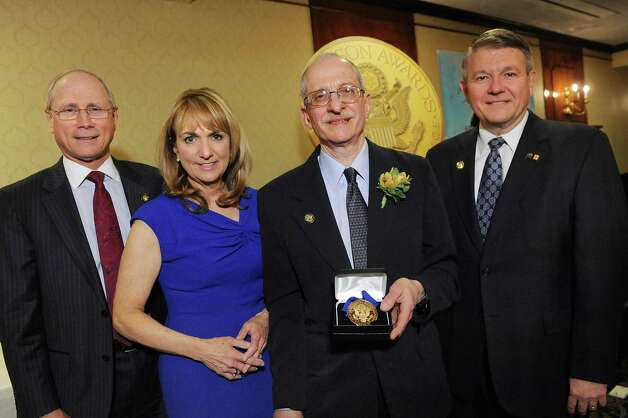 Jefferson Award medalist Steve Kozlowski, second from right, joins James Reed, president and CEO of St. Peter's Health Partners, left; Benita Zahn of NewsChannel 13, second from left; and Stephen Baboulis, vice president and general manager of WNYT/WNYA, at the awards dinner on Thursday, April 23, 2015, at the Century House in Latham, N.Y. Kozlowski will represent the Capital Region at the National Jefferson Awards in June in Washington, D.C. (Cindy Schultz / Times Union) Photo: Cindy Schultz / 00031490A