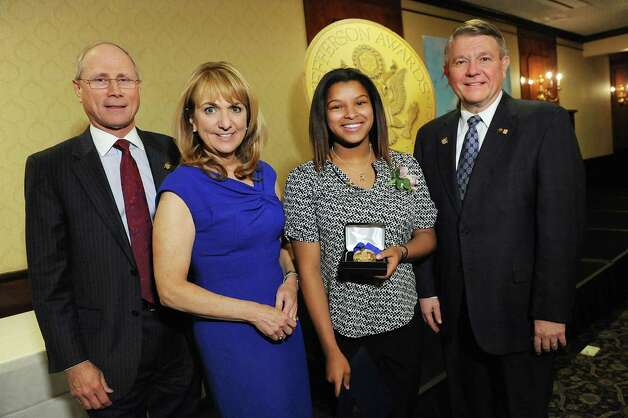 Jefferson Award medalist Sarah Lopez-Long, second from right, joins James Reed, president and CEO of St. Peter's Health Partners, left; Benita Zahn of NewsChannel 13, second from left; and Stephen Baboulis, vice president and general manager of WNYT/WNYA, at the awards dinner on Thursday, April 23, 2015, at the Century House in Latham, N.Y. Kozlowski will represent the Capital Region at the National Jefferson Awards in June in Washington, D.C. (Cindy Schultz / Times Union) Photo: Cindy Schultz / 00031490A