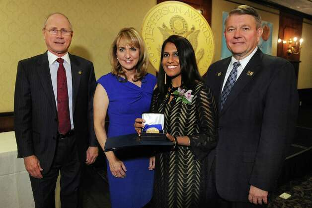 Jefferson Award medalist Fazana Saleem-Ismail, second from right, joins James Reed, president and CEO of St. Peter's Health Partners, left; Benita Zahn of NewsChannel 13, second from left; and Stephen Baboulis, vice president and general manager of WNYT/WNYA, at the awards dinner on Thursday, April 23, 2015, at the Century House in Latham, N.Y. (Cindy Schultz / Times Union) Photo: Cindy Schultz / 00031490A