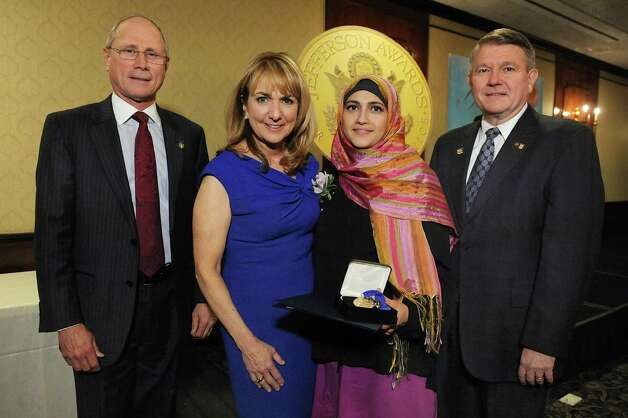 Jefferson Award medalist Uzma Popal, second from right, joins James Reed, president and CEO of St. Peter's Health Partners, left; Benita Zahn of NewsChannel 13, second from left; and Stephen Baboulis, vice president and general manager of WNYT/WNYA, at the awards dinner on Thursday, April 23, 2015, at the Century House in Latham, N.Y. (Cindy Schultz / Times Union) Photo: Cindy Schultz / 00031490A