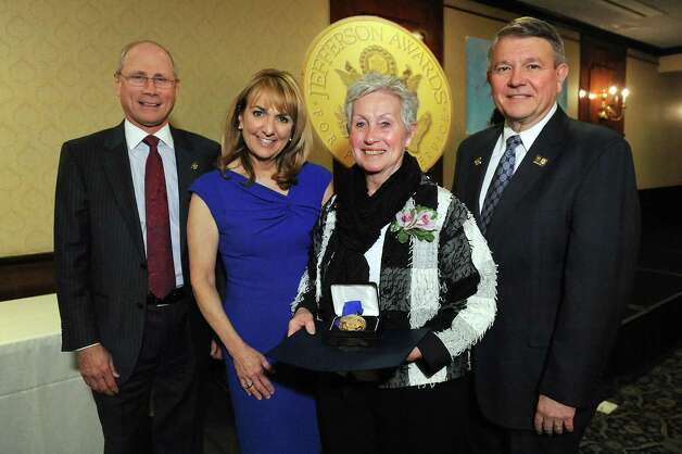 Jefferson Award medalist Donna Drum, second from right, joins James Reed, president and CEO of St. Peter's Health Partners, left; Benita Zahn of NewsChannel 13, second from left; and Stephen Baboulis, vice president and general manager of WNYT/WNYA, at the awards dinner on Thursday, April 23, 2015, at the Century House in Latham, N.Y. (Cindy Schultz / Times Union) Photo: Cindy Schultz / 00031490A