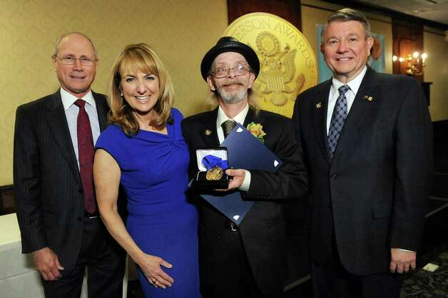 Jefferson Award medalist Paul Cooke, second from right, joins James Reed, president and CEO of St. Peter's Health Partners, left; Benita Zahn of NewsChannel 13, second from left; and Stephen Baboulis, vice president and general manager of WNYT/WNYA, at the awards dinner on Thursday, April 23, 2015, at the Century House in Latham, N.Y. (Cindy Schultz / Times Union) Photo: Cindy Schultz / 00031490A