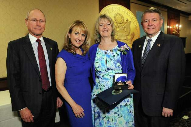 Jefferson Award medalist Mary Partridge-Brown, second from right, joins James Reed, president and CEO of St. Peter's Health Partners, left; Benita Zahn of NewsChannel 13, second from left; and Stephen Baboulis, vice president and general manager of WNYT/WNYA, at the awards dinner on Thursday, April 23, 2015, at the Century House in Latham, N.Y. (Cindy Schultz / Times Union) Photo: Cindy Schultz / 00031490A
