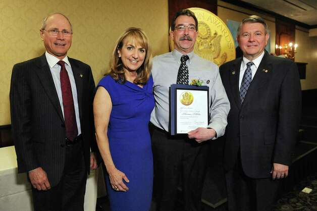 Jefferson Award finalist Thomas Tibbitts, second from right, joins James Reed, president and CEO of St. Peter's Health Partners, left; Benita Zahn of NewsChannel 13, second from left; and Stephen Baboulis, vice president and general manager of WNYT/WNYA, at the awards dinner on Thursday, April 23, 2015, at the Century House in Latham, N.Y. (Cindy Schultz / Times Union) Photo: Cindy Schultz / 00031490A