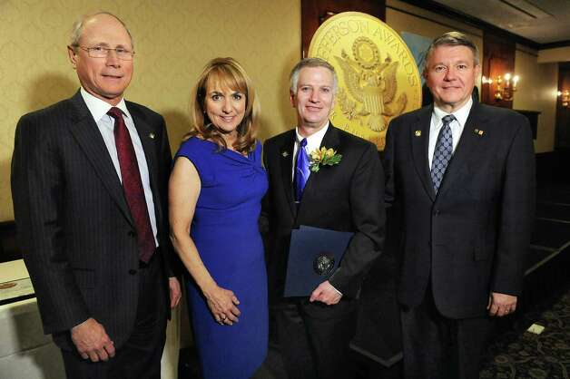 Jefferson Award finalist Peter Hilton, second from right, joins James Reed, president and CEO of St. Peter's Health Partners, left; Benita Zahn of NewsChannel 13, second from left; and Stephen Baboulis, vice president and general manager of WNYT/WNYA, at the awards dinner on Thursday, April 23, 2015, at the Century House in Latham, N.Y. (Cindy Schultz / Times Union) Photo: Cindy Schultz / 00031490A