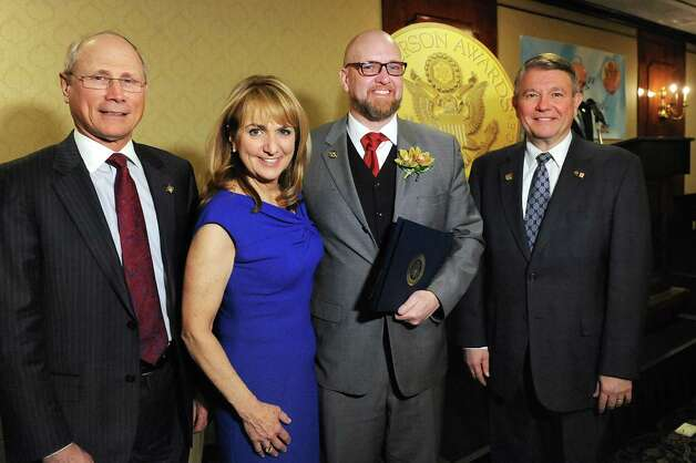 Jefferson Award finalist James Melvin Ader, second from right, joins James Reed, president and CEO of St. Peter's Health Partners, left; Benita Zahn of NewsChannel 13, second from left; and Stephen Baboulis, vice president and general manager of WNYT/WNYA, at the awards dinner on Thursday, April 23, 2015, at the Century House in Latham, N.Y. (Cindy Schultz / Times Union) Photo: Cindy Schultz / 00031490A