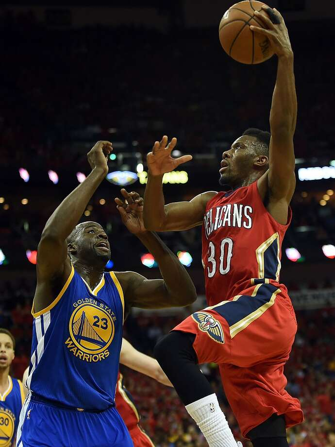 NEW ORLEANS, LA - APRIL 23:  Norris Cole #30 of the New Orleans Pelicans drives to the basket against Draymond Green #23 of the Golden State Warriors during the first half of Game Three in the first round of the 2015 NBA Playoffs at the Smoothie King Center on April 23, 2015 in New Orleans, Louisiana. NOTE TO USER: User expressly acknowledges and agrees that, by downloading and or using this photograph, User is consenting to the terms and conditions of the Getty Images License Agreement.  (Photo by Stacy Revere/Getty Images) Photo: Stacy Revere, Getty Images